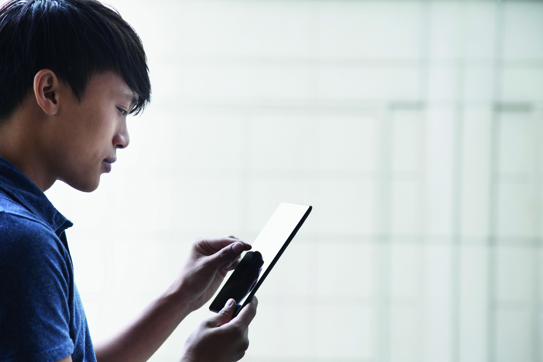 Vietnamese businessman using digital tablet